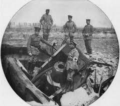 German soldiers inspect Belgian artillery destroyed by retreating Belgian troops, on the road to Brussels, August 1914