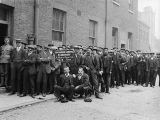 Reservists of the Grenadier Guards line up for medical inspection, London 1914