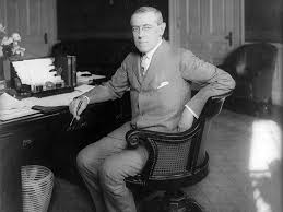 Wilson at his desk in the White House, date uncertain
