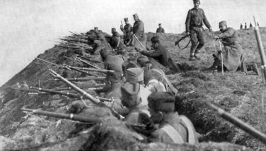 Serbs fighting in shallow trenches, face the forces of Austria-Hungary