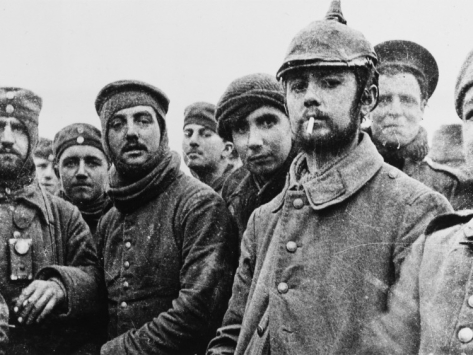 British and German soldiers meet in No-Man's-Land on Christmas Day 1914
