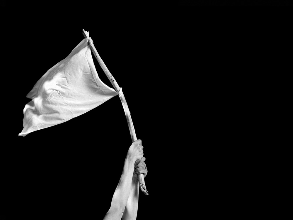 White flag, a symbol of surrender, used by Germans to hide machine-gunners.