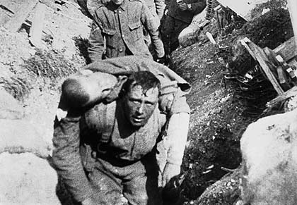 One solder carries a severely wounded comrade, Western Front, date uncertain