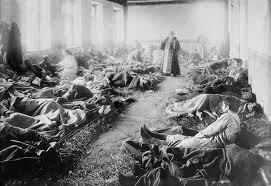 Typical World War One field hospital, lacking beds and adequate medicine.