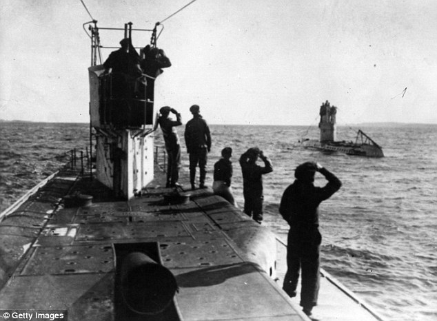 German U-boat crew on surfacing submarine, date and place uncertain.