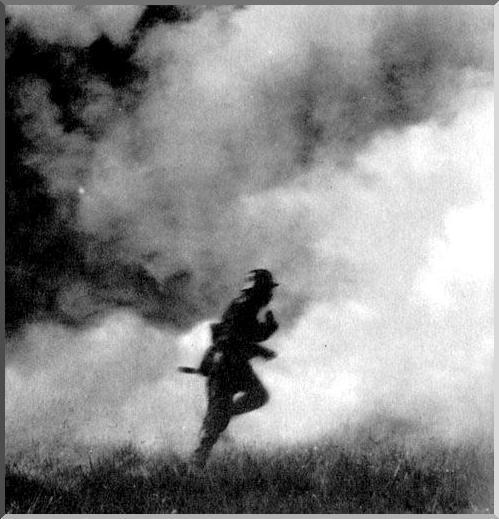 A rare photo of German soldier in a German gas cloud, Ypres, May 1915.