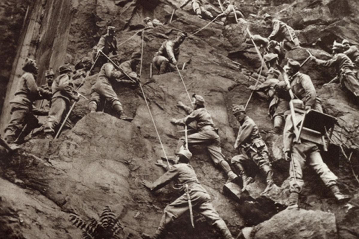 Austrian troops climbing over mountain pass to surprise Italians on the Isonzo Front, 1915.