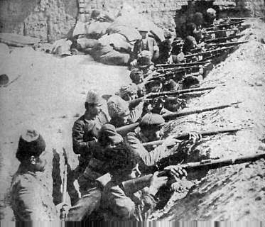Turkish troops in their trenches prepare for Allied attack, circa 1915.