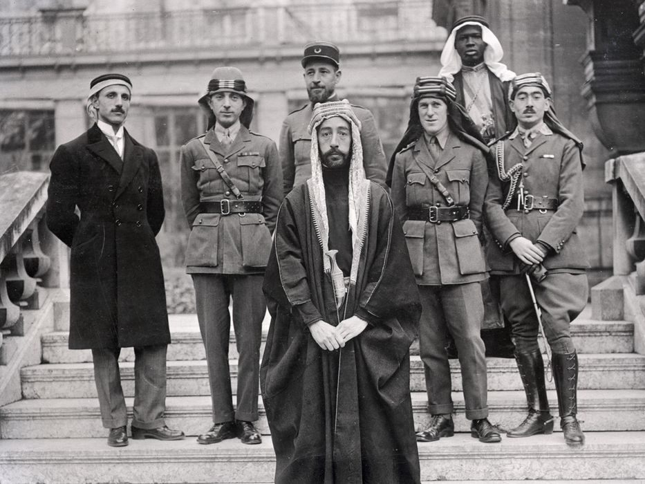 Arab leaders gather to plot revolt. T.E. Lawrence third from right, Faisal center.