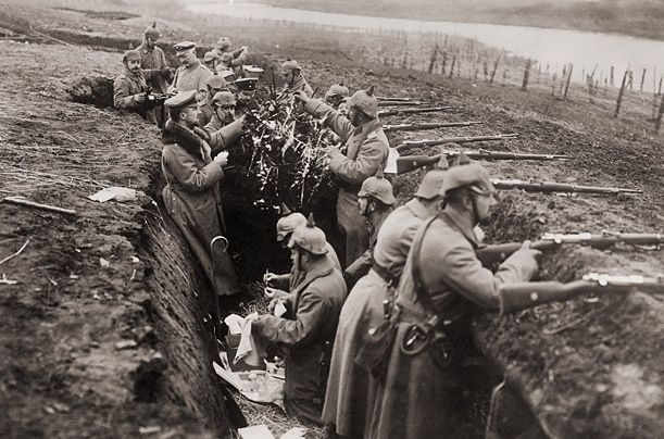 German troops in their trenches on the watch for British attacks as they decorate a makeshift Christmas tree.