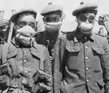 French soldiers wear primitive gas masks on the Western Front.