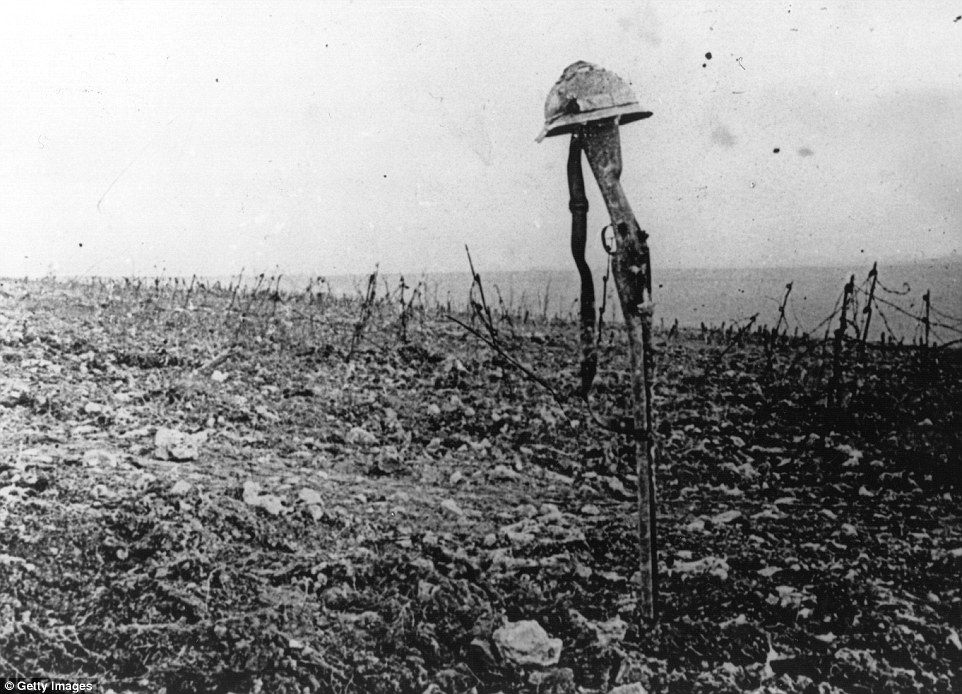Helmet and rifle mark where a soldier fell, Verdun, 1916.