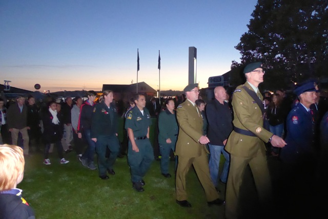 Service personnel march at the conclusion of the Anzac Day ceremony in Paihia, New Zealand.