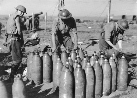British soldiers prepare artillery shells for Battle of the Somme, summer 1916.