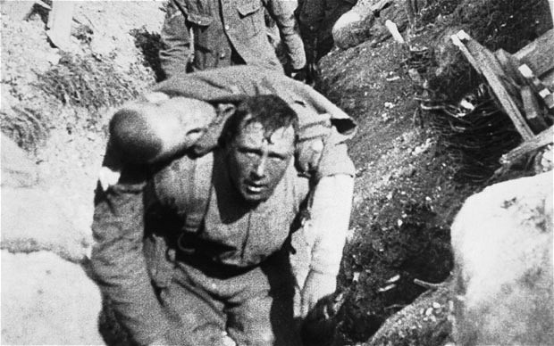 British soldier at Somme rescued by comrade, circa July 1916.