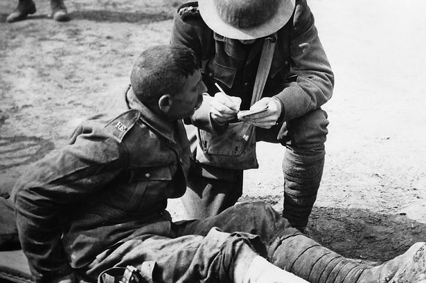 Taking the names of the wounded at the Somme.