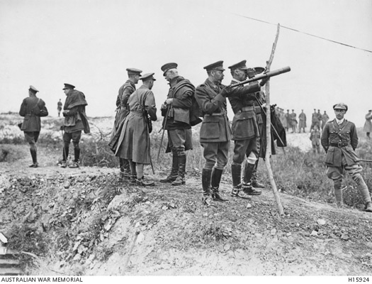 King George V observes fighting at the Somme, date uncertain.