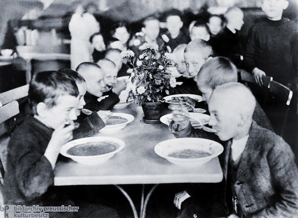 A soup kitchen and food rations for children in Germany, date and place uncertain.