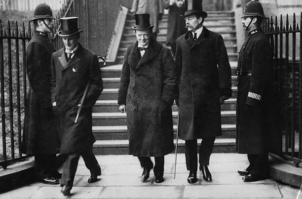 Sir Edward Grey, second from left, and Winston Churchill, center.