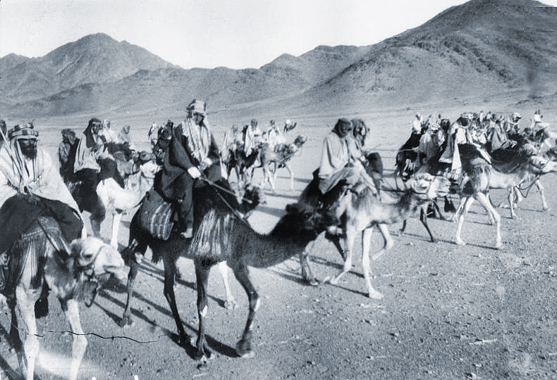Arabs fighting the Arab Revolt, with Lawrence riding camel in the foreground left.